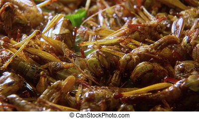 Appetizing Fried Grasshoppers, Thailand - Close-up low angle...