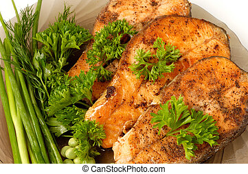 Appetizing fried salmon fish with vegetables on a plate