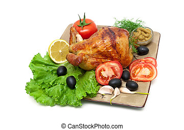 Appetizing grilled chicken with vegetables and herbs on a plate.