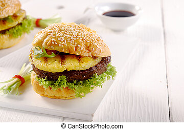 Appetizing Hawaiian Burger on a White Table