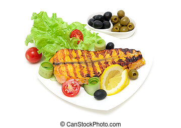 piece of baked salmon with lemon and vegetables on the plate on a white background
