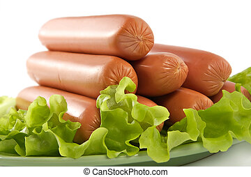 Appetizing pork sausages seasoned by green salad-product for...