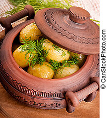 Appetizing potato in a pot with fennel of a fresh crop