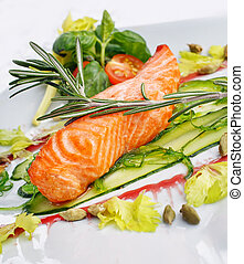 Salmon fish with herbs, appetizing restaurant food