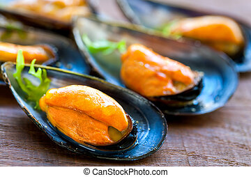 Macro close up of fresh steamed blue sea mussels.