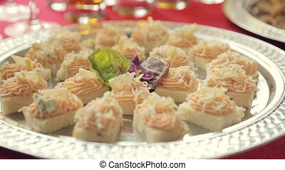 Appetizing small sandwiches with cream cheese, lemon and a...