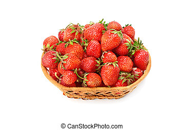 Appetizing strawberries in a wicker basket isolated on a white background.