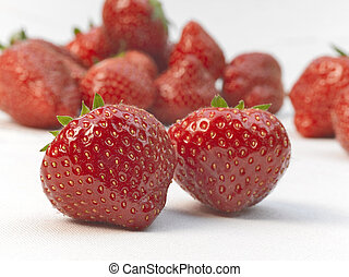 Appetizing strawberries with leaves