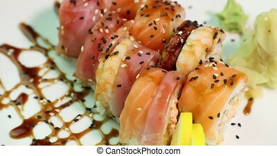 appetizing sushi on a white plate revolve around its axis...