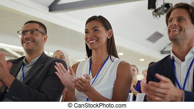 Applauding audience at a business seminar - Close up front ...
