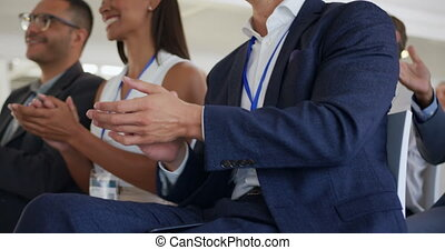 Applauding audience at a business seminar - Close up side ...