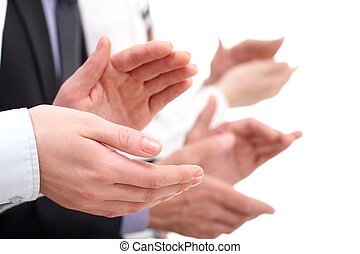 Photo of businesswoman?s hands applauding at background of partners