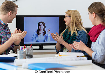 Applause after report at business video conference