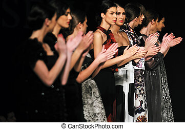 applause people group on fashion show