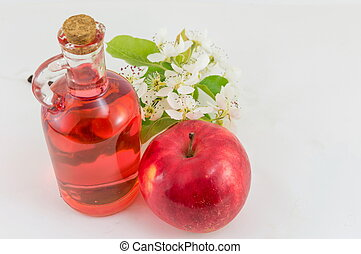 Red apple and apple vinegar decorated with flowers