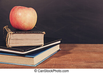 Apple and Books with Blackboard Background