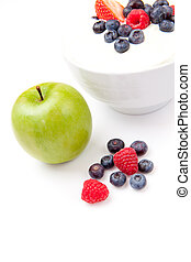 Apple and bowl of berries cream