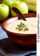 Apple and Leek Soup on a rustic table