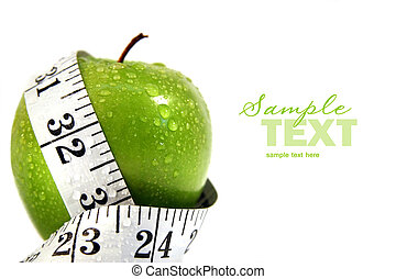 Apple and measuring tape against white background