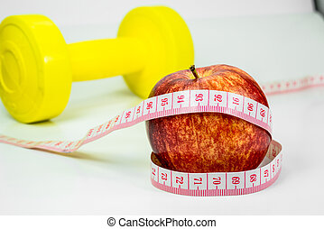 apple and measuring tape