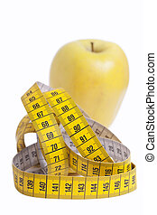 Apple and measuring tape.