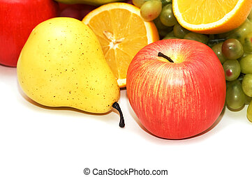 Apple and pear and other fruits at background