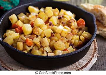 Apple and root vegetable hash with potato, carrots and...