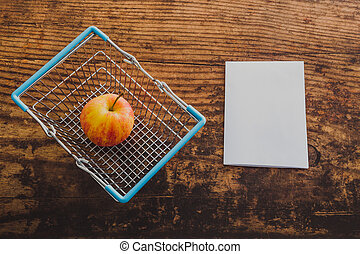 apple and shopping basket with copyspace on memo paper all ...