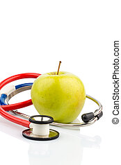 apple and stethoscope - an apple and a stethoscope on a...