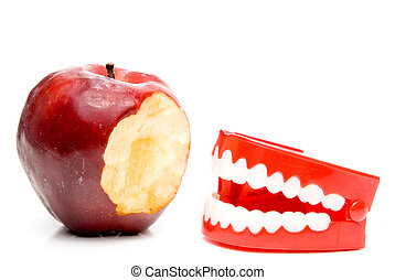 Apple and Teeth - An apple a day keeps the doctor away.