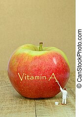 Apple and vitamin A - An apple with vitamin A written on the...
