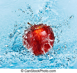Apple and water - fresh water splash on red apple