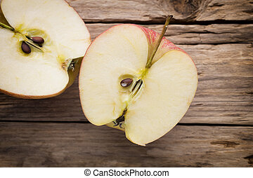 Apple on the wooden background.