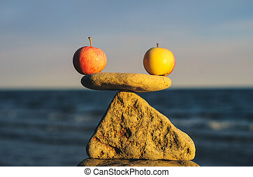 Apple balance - Balancing of apples on the top of triangle...