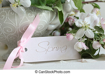 Apple blossom flowers in vase with gift card