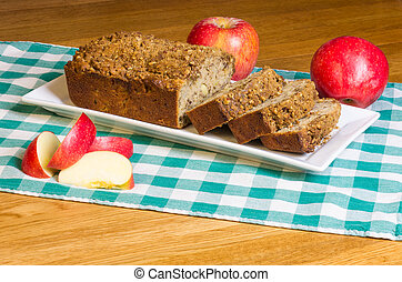Apple cake with apples on white plate - Freshly baked apple...