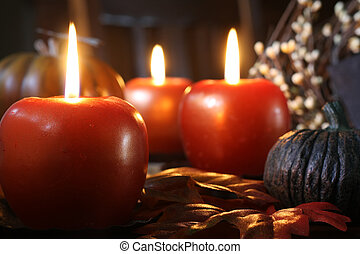 Apple candles - Apple shaped candles surrounded by autumn...