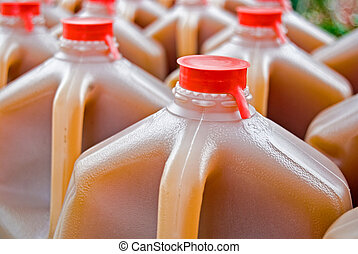 Apple Cider - Apple cider in plastic gallon jugs.