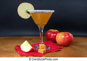 apple cider cocktail with caramel candy