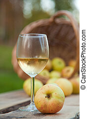 apple cider in a chilled wine glass, rustic settings with...