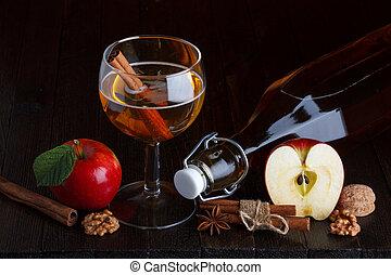apple cider still life with cinnamon stick, apple, walnut,...