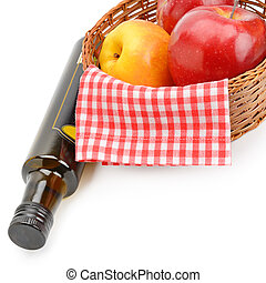 Apple cider vinegar in a bottle and ripe apples isolated on white background.