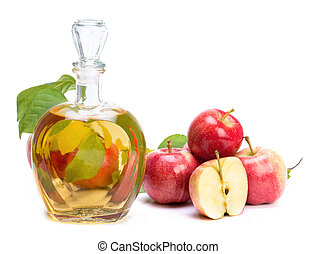 apple cider vinegar in a glass vessel and red apples...