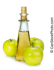 apple cider vinegar in a glass vessel and green apples...