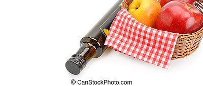 Apple cider vinegar in bottle and ripe apples isolated on white background. Free space for text. Wide photo