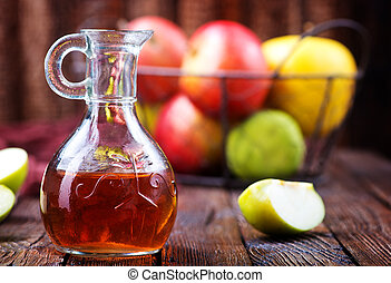 Apple cider vinegar in bottle and on a table