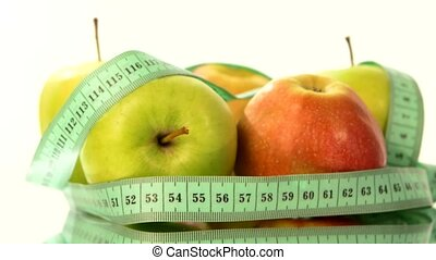 Apple collection with measuring tape, rotation, reflection, on white