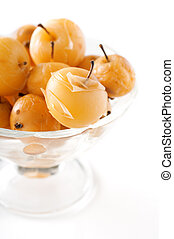 Apple compote in a glass vase on white background