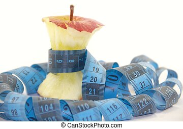 Apple core with a blue tape measure