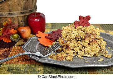 Apple crisp dessert with fall leaves.